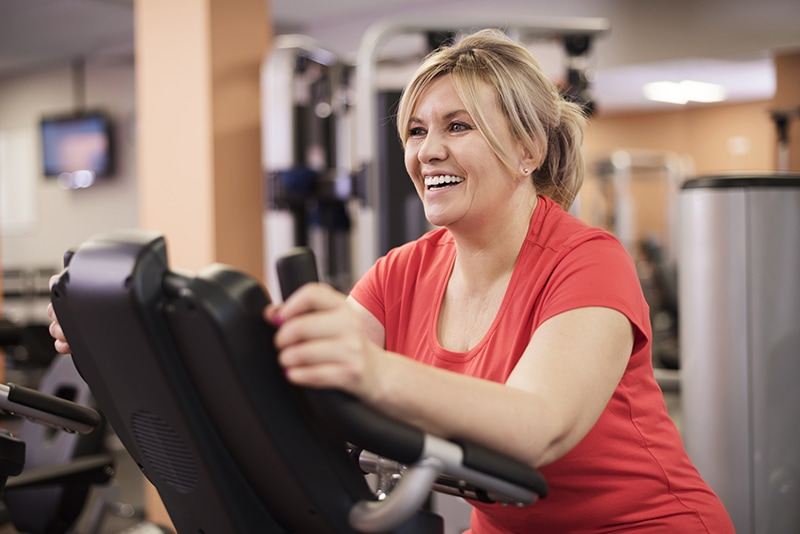 woman working out on cardio equipment
